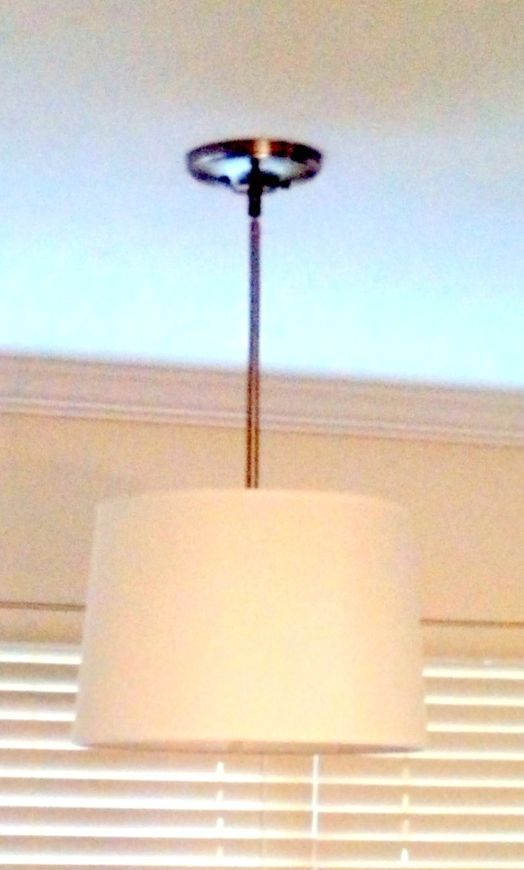 Pardon the poor lighting in this photo. The downrod on this appears to be ORB but it's really a brushed nickel finish